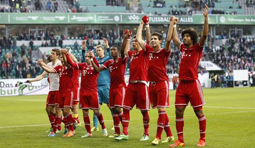 Bayern Munich's team celebrate after their German first division Bundesliga soccer match against Wolfsburg in Wolfsburg