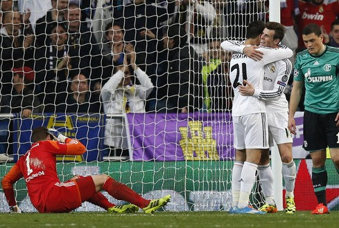 Real Madrid's Morata is congratulated by his teammate Bale after scoring a goal against Schalke 04 during their Champions League last 16 second leg soccer match at Santiago Bernabeu stadium in Madrid